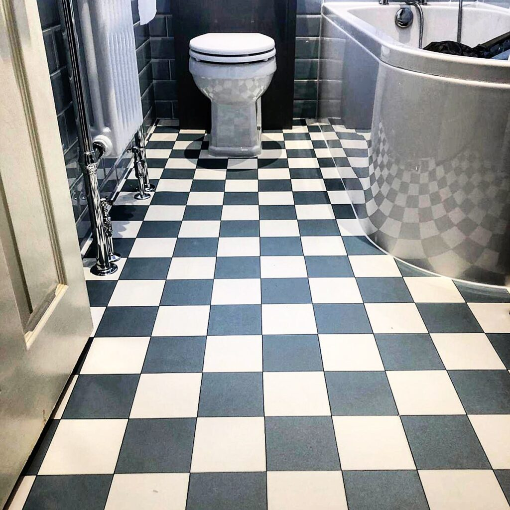 A splendant bathroom showing the classic decorative black and white tiles - this floor is vinyl. From a customer of ours in Tunbridge Wells