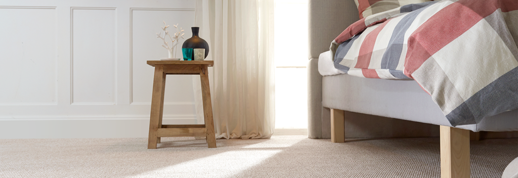 A beautiful carpet in a bedroom. With a lovely bed. Why not choose affordable flooring solutions to help choose yours?
